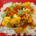 A dish of tangy cumin veggie curry on a bed of rice